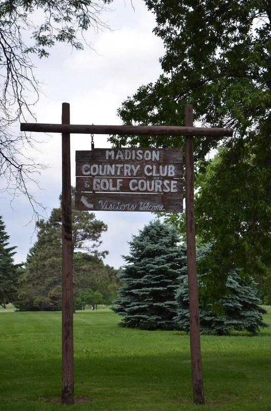 A sign at Madison Country Club and Golf Course