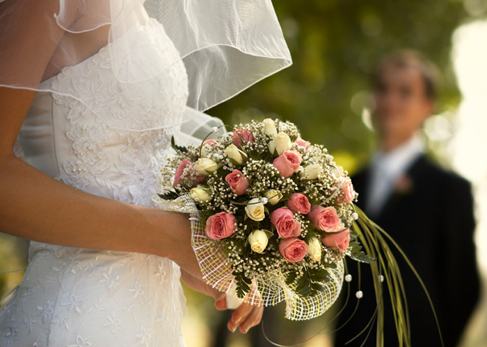 Flower bouquet being held by a bride
